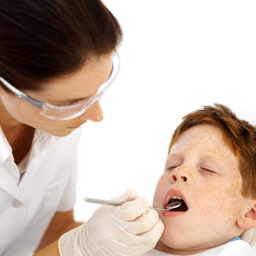 Dentist Examining Little Boys Teeth